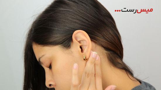 گوشهای خود را بمالید